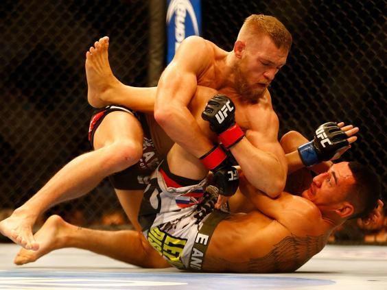 McGregor fighting Holloway at UFC Boston in August 2013 Getty